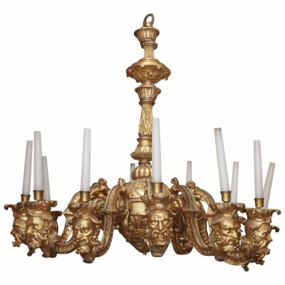 French Regence Style Carved Giltwood Twelve-Light Chandelier