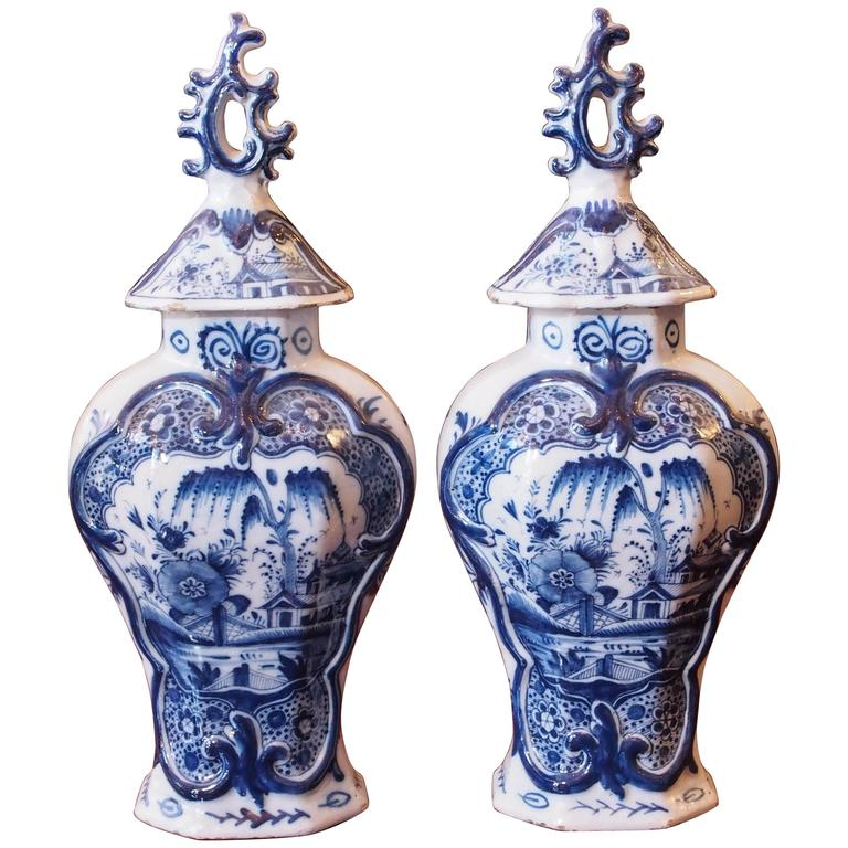 Pair of Delft Blue and White Lidded Garniture Vases